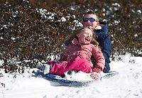 Lydia Anderson, 6 (from left) and Jaxon Anderson, 7, of Bella vista sled, Thursday, February 18, 2021 at Tanyard Creek in Bella Vista. Check out nwaonline.com/210219Daily/ for today's photo gallery. <br /> (NWA Democrat-Gazette/Charlie Kaijo)