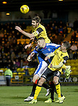 Declan Gallagher leaps over Kenny Miller and Rob Kiernan to clear the danger for Livi