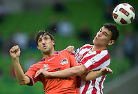 MELBOURNE, AUSTRALIA - NOVEMBER 14: Thomas Broich of the Roar and Eli Babalj of the Heart compete for the ball during the round 14 A-League match between the Melbourne Heart and Brisbane Roar at AAMI Park on November 14, 2010 in Melbourne, Australia (Photo by Sydney Low / Asterisk Images)