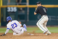 Coastal Carolina Chanticleers second baseman Tyler Chadwick (8) turns a double play as Florida Gators baserunner Buddy Reed (23) slides into second base during Game 4 of the NCAA College World Series on June 19, 2016 at TD Ameritrade Park in Omaha, Nebraska. Coastal Carolina defeated Florida 2-1. (Andrew Woolley/Four Seam Images)
