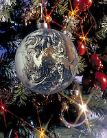 The Earth represented as a Christmas ornament. peace, holiday. natural resources, gifts.