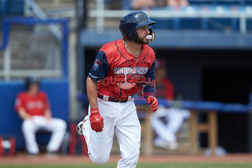 Nick Lovullo (6) of the San Bernardos de Salem blows a bubble with his gum as he runs towards first base during the game against the Winston-Salem Dash at Haley Toyota Field on June 30, 2019 in Salem, Virginia. The Dash defeated the San Bernardos 3-2. (Brian Westerholt/Four Seam Images)