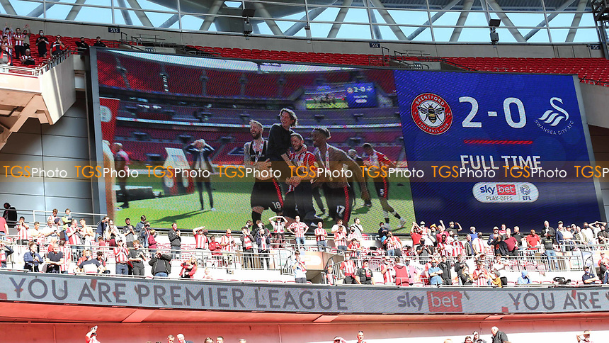 The Big Screen at Wembley displays the final score and Brentford celebrate promotion to the Premier League during Brentford vs Swansea City, Sky Bet EFL Championship Play-Off Final Football at Wembley Stadium on 29th May 2021