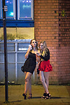 """© Joel Goodman - 07973 332324 . 16/12/2017. Manchester, UK. A woman leans on another women at Deansgate Locks . Revellers out in Manchester City Centre overnight during """" Mad Friday """" , named for historically being one of the busiest nights of the year for the emergency services in the UK . Photo credit : Joel Goodman"""