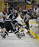 1 February 2008: University of Vermont Catamounts' forward Wahsontiio Stacey, a Freshman from Kahnawake, Quebec, attempts to maintain control of the puck against the University of New Hampshire Wildcats at Gutterson Fieldhouse in Burlington, Vermont. The seventh-ranked Wildcats defeated the Catamounts 5-1in front of a sellout crowd of 4,003...Mandatory Photo Credit: Ed Wolfstein Photo