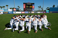 Michigan Wolverines team huddle before a game against Army West Point on February 18, 2018 at Tradition Field in St. Lucie, Florida.  Michigan defeated Army 7-3.  (Mike Janes/Four Seam Images)