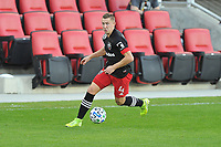 WASHINGTON, DC - NOVEMBER 8: Russell Canouse #4 of D.C. United moves the ball during a game between Montreal Impact and D.C. United at Audi Field on November 8, 2020 in Washington, DC.