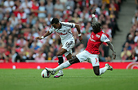 Pictured L-R: Scott Sinclair of Swansea avoiding a tackle by Bacary Sagna of Arsenal. Saturday 10 September 2011<br />
