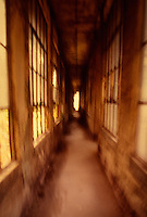 Available directly from Jeff as a fine art print.<br /> <br /> Available for commercial and editorial licensing exclusively from www.gettyimages.com  Please search for image # 10133917<br /> <br /> Abandoned Corridor Leading to Open Door, Ellis Island National Monument - Contagious Disease Ward, New York Harbor, New York City, New York State, USA