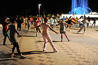 LAO PDR Vientiane, people do Aerobic in the evening at Mecong river / Laos Vientiane , Aerobic Veranstaltung am Mekong Fluss am Abend