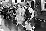 Two women having a laugh, friendship 1970s May 29th Garland Day. Castleton Derbyshire. <br />  1972 Uk