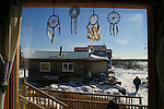 Dream-catchers hang in the front window of Reverend Ellen Bruce's house in Old Crow, Yukon Territory, Canada. Bruce is a member of the Vuntut Gwitchin First Nation.