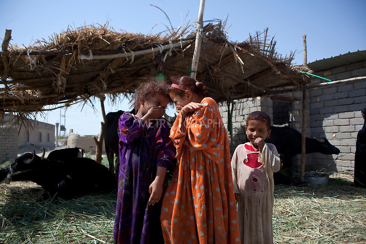 AL-SELKHA, IRAQ: Two girls laugh while they have their photo taken in the village of Al Selkha...Dozens of families displaced by years of violence live in the village of Al Selkha in Nasiriya...Photo by Ali Arkady/Metrography