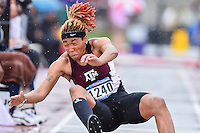 LaQue Moen-Davis of Texas A&M competes in first round of long jump during West Preliminary Track & Field Championships at John McDonnell Field, Thursday, May 29, 2014 in Fayetteville, Ark. (Mo Khursheed/TFV Media via AP Images)