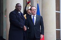French President Francois Hollande greets Senegal's President Macky Sall (L) as he arrives at the Elysee Palace during a visit in Paris as part of his state visit to France, December 20, 2016. # FRANCOIS HOLLANDE RECOIT MACKY SALL, LE PRESIDENT DU SENEGAL, A L'ELYSEE