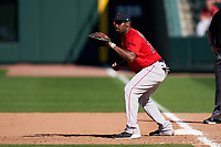 Boston Red Sox first baseman Josh Ockimey (76) holds a runner on during a Major League Spring Training game against the Atlanta Braves on March 7, 2021 at CoolToday Park in North Port, Florida.  (Mike Janes/Four Seam Images)