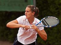 12-8-09, Den Bosch,Nationale Tennis Kampioenschappen, 1e ronde,   Lisane van Riet in de regen