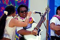 Woman giving musician a lei at the Hawaiian slack key guitar festival