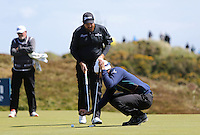 Sunday 31st May 2015; Sunday 31st May 2015; Seve Benson, England, calls Shane Lowry, Ireland, over to look at his ball that was moved by the wind on the 8th green<br /> <br /> Dubai Duty Free Irish Open Golf Championship 2015, Round 4 County Down Golf Club, Co. Down. Picture credit: John Dickson / DICKSONDIGITAL