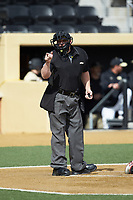 Home plate umpire Wilson Raynor makes a strike call during the ACC baseball game between the Louisville Cardinals and the Wake Forest Demon Deacons at David F. Couch Ballpark on March 18, 2018 in  Winston-Salem, North Carolina.  The Demon Deacons defeated the Cardinals 6-3.  (Brian Westerholt/Four Seam Images)