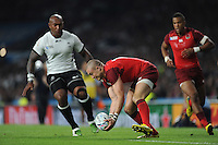 Mike Brown of England picks up a loose ball as Nemani Nadolo of Fiji bears down on him during Match 1 of the Rugby World Cup 2015 between England and Fiji - 18/09/2015 - Twickenham Stadium, London <br /> Mandatory Credit: Rob Munro/Stewart Communications