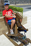 Chück Düdek On Toy Horse, Cumbaya