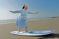 """NEW YORK - FOR SUNDAY NEWS:  Nuns from the """"Sister Servants of the Immaculate Heart of Mary"""" that like to surf, Stone Harbor, NJ on Friday, August 20 , 2010.  (Photo by Angel Chevrestt, 646.314.3206)<br /> <br /> PICTURED:  Sister James with a surf board and the Atlantic Ocean behind her."""