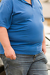 Ordinary middle aged fat man on holiday Wales. UK 2008. Wear blue polo shirt.