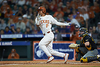 Trey Faltine (0) of the Texas Longhorns follows through on his swing against the Missouri Tigers in game eight of the 2020 Shriners Hospitals for Children College Classic at Minute Maid Park on March 1, 2020 in Houston, Texas. The Tigers defeated the Longhorns 9-8. (Brian Westerholt/Four Seam Images)