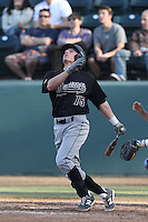 Jimmy Allen #15 of the Cal Poly Mustangs bats against the UCLA Bruins at Jackie Robinson Stadium on February 22, 2014 in Los Angeles, California. Cal Poly defeated UCLA, 8-0. (Larry Goren/Four Seam Images)