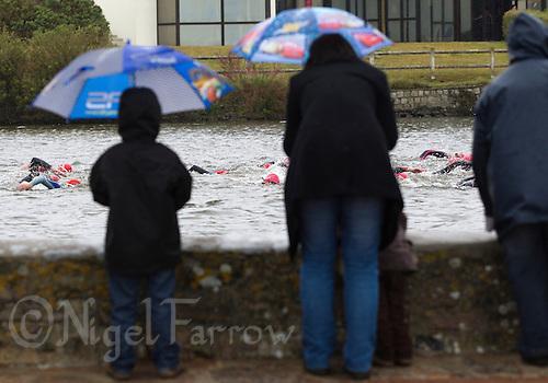 28 APR 2012 - LES SABLES D'OLONNE, FRA - Spectators watch the swim during the short distance race during the Triathlon des Sables d'Olonne in Les Sables d'Olonne, France .(PHOTO (C) 2012 NIGEL FARROW)