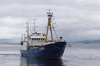 Covered harpoon gun on bow of Norwegian whaling boat leaving harbour Norwegian sea Arctic Norway North Atlantic