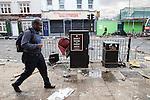 © Joel Goodman - 07973 332324 . 07/08/2011 . London , UK . People on Tottenham High Street . Overnight rioting and looting in Tottenham , following a protest against the police shooting of Mark Duggan . Photo credit : Joel Goodman