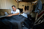 A Roma tailor in Suto Orizari, Macedonia. The mostly Roma community, located just outside Skopje, is Europe's largest Roma settlement. .