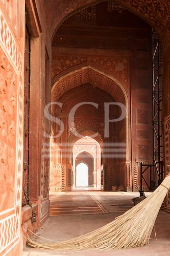 Agra, Utar Pradesh, India. Taj Mahal; red sandstone mosque to the side of the mausoleum.