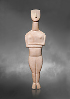 Cycladic Canonical type, Spedos variety female figurine statuette from Naxos or Keros. Early Cycladic Period II, (2800-2300 BC), 'Goulandris Master'.  Museum of Cycladic Art Athens,  Against Grey Background. <br /> <br /> The 'Goulandris Master' was named because of the N.P Goulandris collection which had a significat number of Cycladic figureines attributed to one sculptor. The characteristic traits of his work are : statues of 32 to 98 cm tall, precise incisions demarcating the neck, the abdomen and pubic triangle asv well as knees and spinal column, the statues have a rounded outline. Traces of colour were found on the statue.
