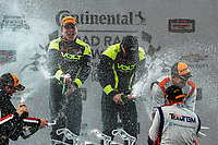 #7 VOLT Racing, Ford Mustang GT4, GS: Alan Brynjolfsson, Trent Hindman, podium, champagne