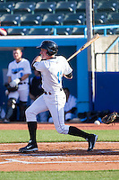 Alec Sole (11) of the Hudson Valley Renegades follows through on his swing against the Brooklyn Cyclones at Dutchess Stadium on June 18, 2014 in Wappingers Falls, New York.  The Cyclones defeated the Renegades 4-3 in 10 innings.  (Brian Westerholt/Four Seam Images)