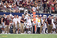 Arkansas safety Rohan Gaines (26) prevents Texas A&M wide receiver Sabian Holmes (23) from making a catch during an NCAA Football game, Saturday, September 27, 2014 in Arlington, Tex. Arkansas leads 21-14 at the halftime. (Mo Khursheed/TFV Media via AP Images)