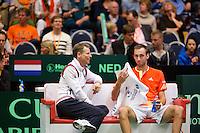 08-04-12, Netherlands, Amsterdam, Tennis, Daviscup, Netherlands-Rumania, Thomas Schoorel op de bank met captain Jan Siemerink