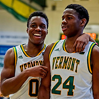 8 December 2018: University of Vermont Guard Stef Smith (0), a Sophomore from Ajax, Ontario, and Guard Ben Shungu (24), a Redshirt Sophomore from Burlington, VT, leave the court after a game against the Harvard University Crimson at Patrick Gymnasium in Burlington, Vermont. The America East Catamounts overcame a 10-point 2nd half deficit, to defeat the Ivy League Crimson 71-65 in NCAA Division I inter-league play. Mandatory Credit: Ed Wolfstein Photo *** RAW (NEF) Image File Available ***