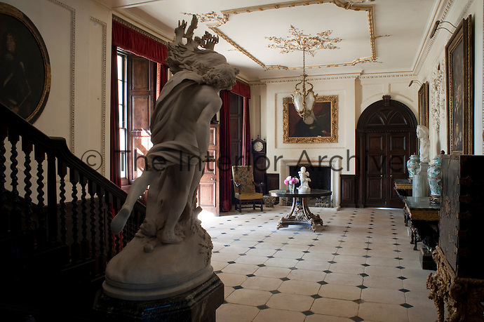 The grand entrance hall is dominated by a copy of Bellini's Apollo and Diana