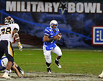 Air Force quarterback Tim Jefferson runs up the middle in then Military Bowl at Robert F. Kennedy Stadium in Washington, D.C. on December 28, 2011. Toledo defeated Air Force 42-41 after a failed two-point conversion in the final minute.