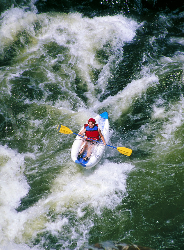 above angle view of woman riding rapids in inflatable kayak on the Klamath River. woman. California USA Klamath River.