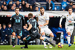 Karim Benzema (r) of Real Madrid fights for the ball with Asier Illarramendi Andonegi of Real Sociedad during their La Liga match between Real Madrid and Real Sociedad at the Santiago Bernabeu Stadium on 29 January 2017 in Madrid, Spain. Photo by Diego Gonzalez Souto / Power Sport Images