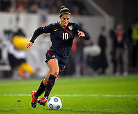 Carli Lloyd dribbles the ball. US Women's National Team defeated Germany 1-0 at Impuls Arena in Augsburg, Germany on October 29, 2009.