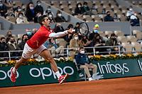 11th October 2020, Roland Garros, Paris, France; French Open tennis, mens singles final 2020;  Novak DJOKOVIC of Serbia hits a return against Rafael NADAL of Spain in the mens final match during the French Open tennis tournament at Roland Garros
