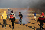 Palestinian protesters clash with Israeli troops following the tents protest where Palestinians demand the right to return to their homeland at the Israel-Gaza border, in Khan Younis in the southern Gaza Strip, on December 27, 2019. Photo by Ashraf Amra