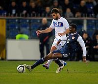 GENOVA, ITALY - February 29, 2012: Antonio Nocerino (l, ITA), Maurice Edu (r, USA), during the friendly match, Italy against USA at the Stadium Luigi Ferraris in Genova, Italy.