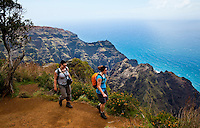 Tourists hiking on Awa'awapuhi trail, Na Pali coastline, Kauai